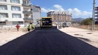 Defne ilçesindeki sokaklarda beton asfalt serimi devam ediyor